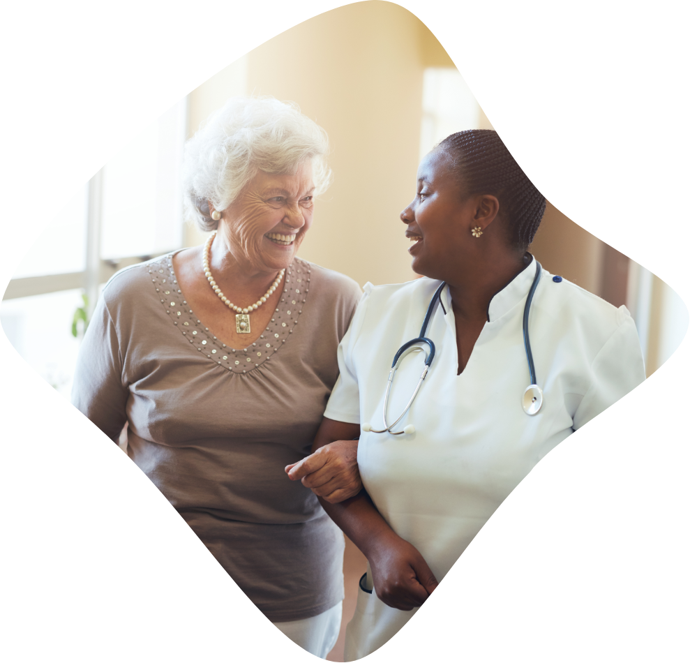 Nurse assisting senior woman for aging care